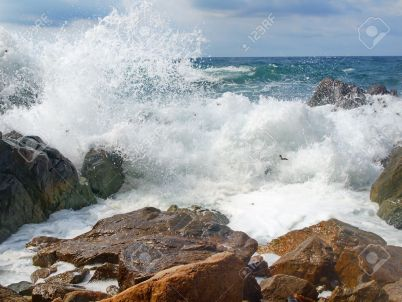 11803762-sea-waves-breaking-on-the-rocks-stock-photo